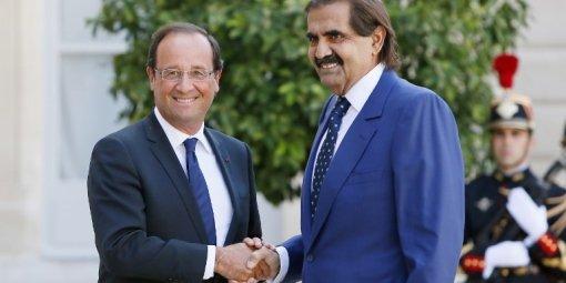 Francois Hollande et l' Emir du Qatar, Sheikh Hamad bin Khalifa Al-Thani à Elysee le 22 août 2012. (AFP - KENZO TRIBOUILLARD)